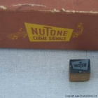 Nutone Logo shown next to period letterpress print block