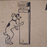 A mechanical doorbell operated by dogs